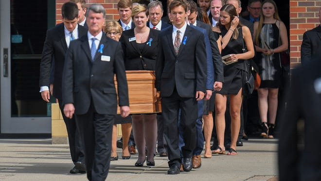 The casket of Otto Warmbier is carried from Wyoming High School after his funeral, Thursday, June 22, 2017, in Wyoming, Ohio. Warmbier, a 22-year-old University of Virginia undergraduate student who was sentenced in March 2016 to 15 years in prison with hard labor in North Korea, died this week, days after returning to the United States.