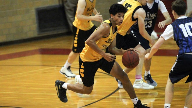 Bettendorf's D.J. Carton takes the ball down court during the Bulldogs' game against Pleasant Valley at Rock Island High School on Saturday, June 24, 2017.