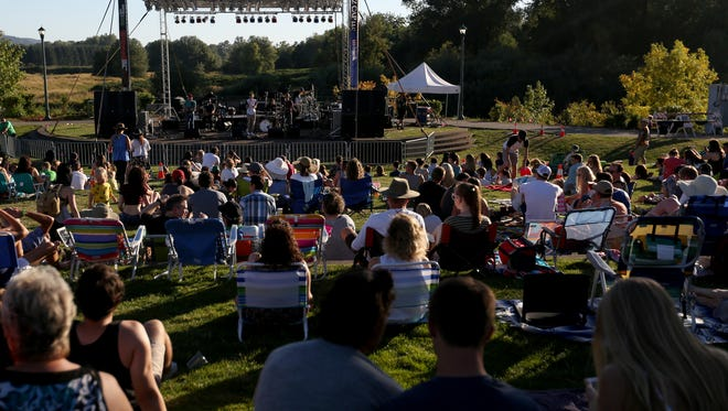 A crowd enjoys a concert during the summer of 2016 at the amphitheater at Salem's Riverfront Park.