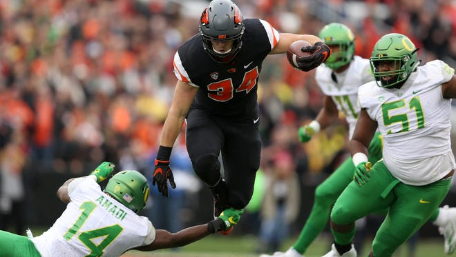 Oregon State's Ryan Nall (34) rushed for 155 yards and four touchdowns in last year's Civil War, a 34-24 victory for the Beavers in Corvallis.