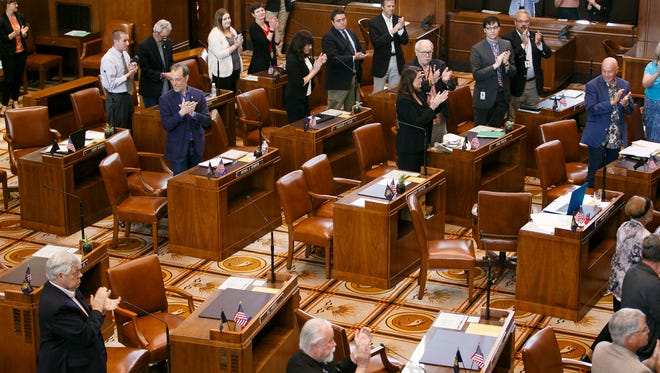 ​Senators applaud as the Sine Die resolution is passed on Friday, July 7, 2017, at the Oregon State Capitol.