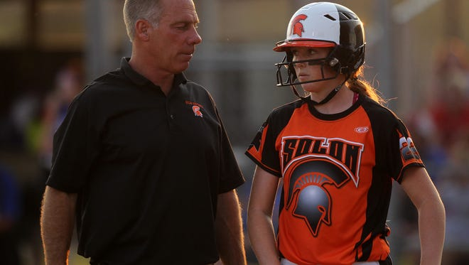 Solon head coach Jim White talks with Jess Heick during the Spartans' regional final against Albia in Solon on Monday, July 10, 2017. Solon lost, 11-3.
