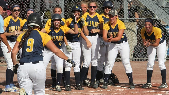 Teammates await Katy Ward after she hit a three-run home run in a big inning for Belle Plaine in their 9-8 loss to Clarksville, Monday, July 17, in Fort Dodge. More pictures of the tournament are in next week's issue of the newspaper.