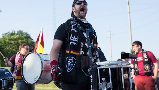 Detroit City FC fan Jordan Smellie of Ferndale chants DCFC during the march towards Keyworth Stadium before a game, on Tuesday, July 18, 2017, in Hamtramck.
