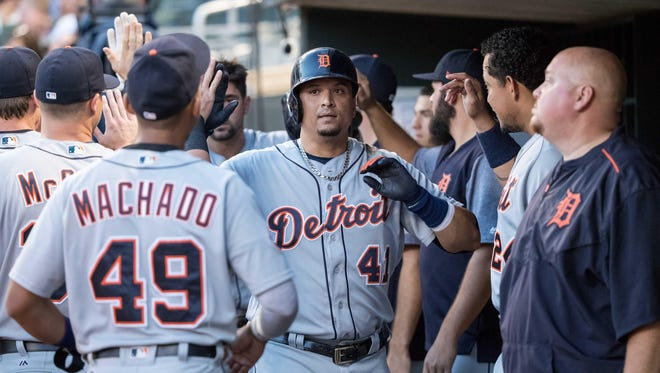 Tigers designated hitter Victor Martinez (41) reacts with teammates after hitting a two-run home run during the fourth inning of the Tigers' 6-3 win on Friday, July 21, 2017, in Minneapolis.