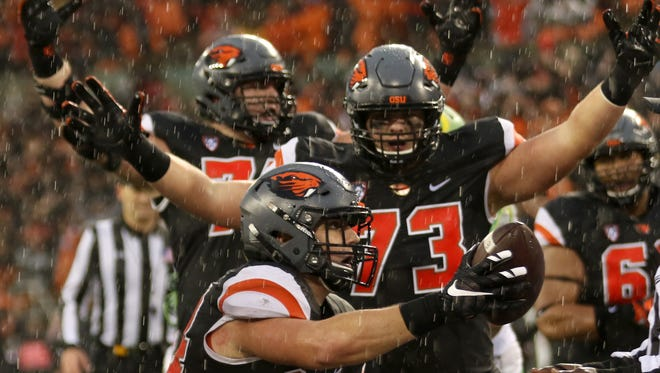 Oregon State's Ryan Nall (34) and teammates had reason to celebrate in a season-ending 34-24 victory over Oregon at Reser Stadium on Nov. 26, 2016.