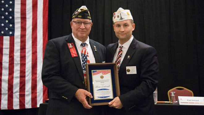 Homer Loudermilk (left) receives the 2017 Distinguished Service Award from Richard Brown, Southern Vice Commander, American Legion Department of Indiana.