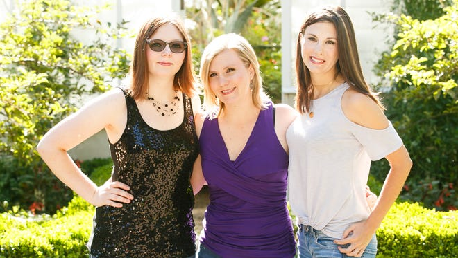 (Left to right) Haley Severin, Amy Severin and Heidi Severin make up The Severin Sisters, a bluegrass-pop group from Salem. Twins Heidi and Amy have been performing together since they were 15-years-old, and have been joined on stage in recent years by younger sister Haley.