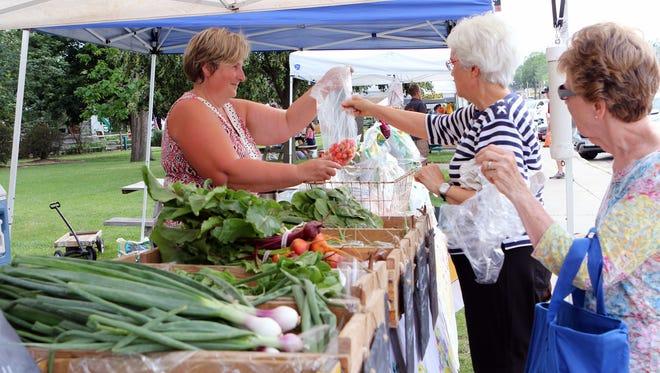 Farmers markets, like the Burlington Farmers Market pictured last summer, provide access to fresh healthy food in communities.