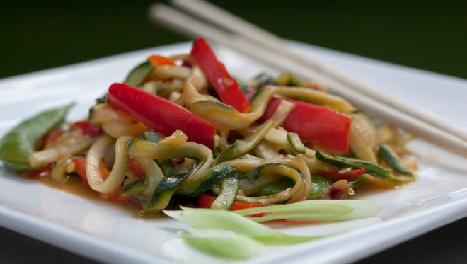 Zoodle Snap Pea Stir Fry for Healthy Table, photographed at Great Lakes Culinary Center in Southfield, Tuesday, August 1, 2017.