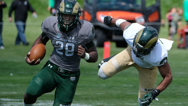 CSU running back Rashaad Boddie shakes a defender during the Green and Gold spring game April 22. Boddie is one of three young running backs making a mark early in fall camp.