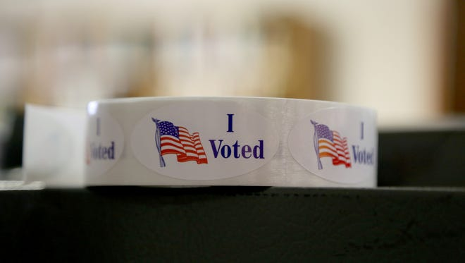 I voted stickers are pictured.