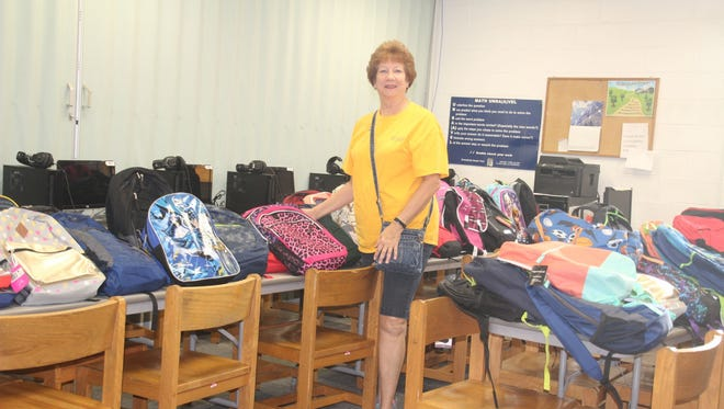 Linda Wilmot Scott of Sunrise Rotary Vero Beach at the Back to School Bash.Sunrise Rotary members volunteered at the event.