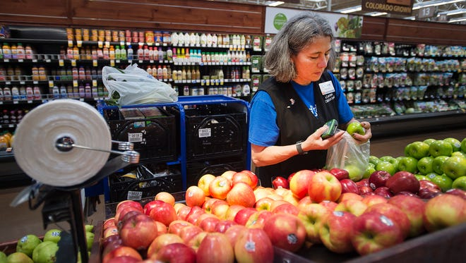 ClickList selector Carmen Avalos carefully picks out a customer's order Friday afternoon, August 11, 2017, King Soopers Marketplace on North College Avenue in Fort Collins, Colo. Fewer than 25 King Soopers workers in Fort Collins are part of United Food and Commercial Workers Local 7 union that will vote on a potential strike Thursday and Friday.