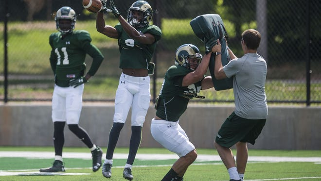 CSU receiver Warren Jackson (9) snags a pass during a team practice earlier in fall camp. Jackson had 71 receiving yards and a touchdown in a closed scrimmage on Saturday.