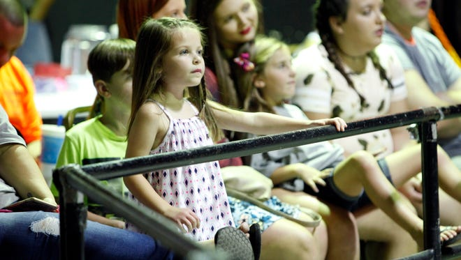 Grace Aikin, 5, watches the wrestling during the River Valley Wrestling (RVW) fundraiser held in Jeffersonville, Ind. to help raise money for a custom wheelchair for Aikin. Born with two rare genetic conditions, Ehlers-Danlos Syndrome and Congenital Myopathy, Aikin has been using a wheelchair on loan from the Muscular Dystrophy Association while raising the roughly $4,000 needed for a wheelchair custom made to fit her body. Aug. 12, 2017