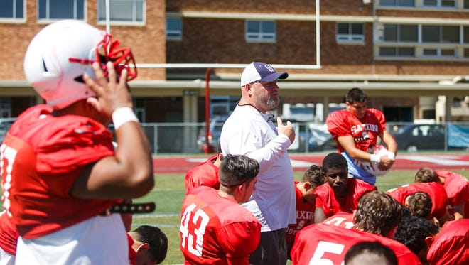 South Salem football head coach Scott DuFault talks to the team following practice on Wednesday, Aug. 16, 2017, in Salem.