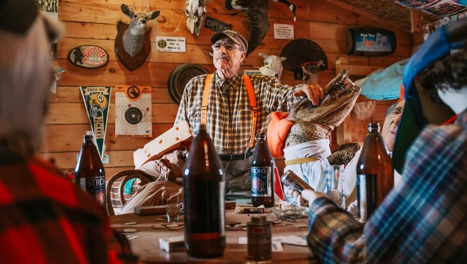 "Jim ""Hoolie"" DeCaire poses for a photo on May 28, 2017 inside Camp Go For Beer, a full-size cabin he built with his band Da Yoopers to film the video for their song ""Second Week of Deer Camp"" at Da Yoopers Tourist Trap in Ishpeming, in Michigan's Upper Peninsula, which has become a popular tourist stop. ""I watch people walking around the whole setup and you hear them laughing out there, and that's the main thing,"" he said. ""They come in the store and you hear them giggling about some of the stuff we sell. It makes me feel great. It makes me feel like I accomplished something."""