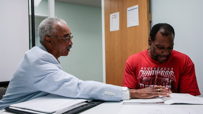 Math tutor James Sutton, 72, left, helps Clarence David Baker, 53, to solve a fraction problem at the Dominican Literacy Center in the Samaritan Center on Detroit's east side in August, 2017.