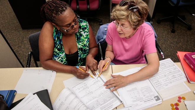 Jaqueline Moore of Detroit, left, gets help from math tutor Mary Theisen on algebra problems during a session at the Dominican Literacy Center in the Samaritan Center in Detroit, Wednesday, August 16, 2017.