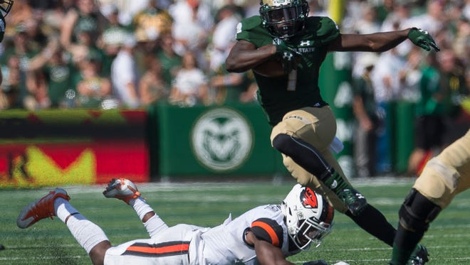 CSU running back Dalyn Dawkins (1) eludes a tackle on a rushing attempt, Saturday, August 26, 2017, at Sonny Lubick Field at Colorado State Stadium in Fort Collins, Colo.