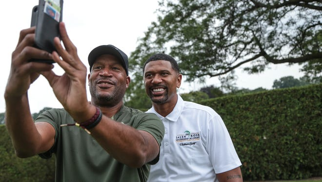 Former NBA player Jalen Rose (right) takes a selfie with former NBA player Ron Harper during the 7th Annual Jalen Rose Leadership Academy Celebrity Golf Classic at The Detroit Golf Club in Detroit on Monday August 28, 2017.