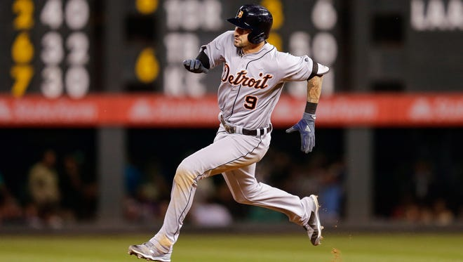 Tigers third baseman Nick Castellanos (9) runs the bases on a two-RBI triple in the third inning on Monday, Aug. 28, 2017, in Denver.