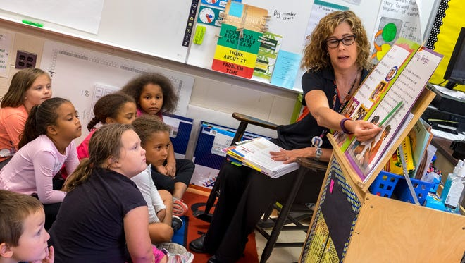 Cleveland Elementary first grade teacher Angela Taylor does a read-aloud with her first-graders Aug. 29. Starting in the 2018-2019 school year, Cleveland Elementary School will house kindergarten through second grade and will focus on literacy.