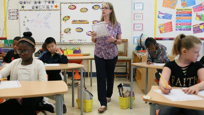 Christina Gurganus, 38, of Rochester Hills teaches her fourth grade class about the bill of rights at Madison Elementary School in Madison Heights, Mich. on Monday, Aug. 28, 2017.  The district is one of 123 schools and districts that have waivers to start the school year before Labor Day.