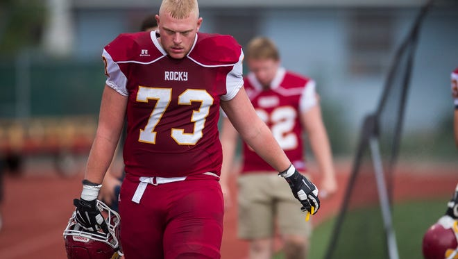 Rocky Mountain High School senior offensive lineman Spencer Lovell (73) walks the sidelines during a game against Columbine High School, Thursday evening, August 31, 2017, at French Field in Fort Collins, Colo.