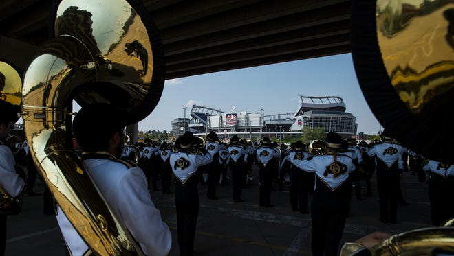 The University of Colorado band practices under the highway, Friday, September 1, 2017, before the Rocky Mountain Showdown at Sports Authority Field at Mile High in Denver, Colo.