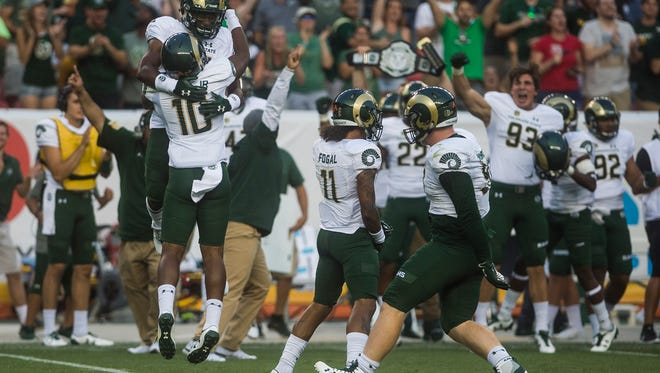 CSU cornerback Kevin Nutt Jr. (10) celebrates an interception of CU quarterback Steven Montez (15) Friday, September 1, 2017, during the Rocky Mountain Showdown at Sports Authority Field at Mile High in Denver, Colo.