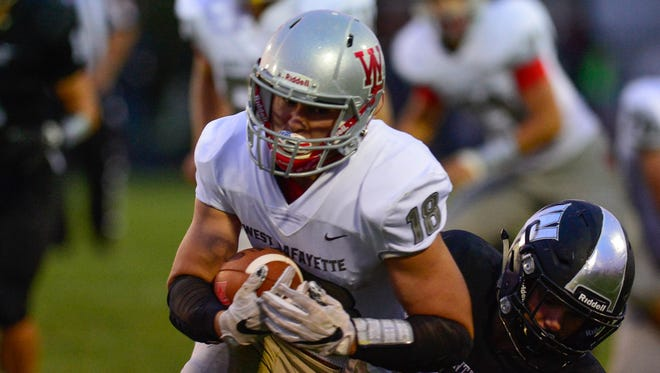 Sage Hood runs for tough yards in West Lafayette's victory at Western.