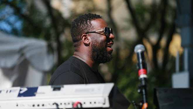 Robert Glasper performs on the piano with  2017 Featured Untitled Artist Karriem Riggins  on the drums and Music with a Purpose Special Guest Common during the 2017 Detroit Jazz Festival in Campus Martius square in Detroit on Sunday, Sept. 3, 2017.