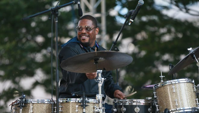 2017 Featured Untitled Artist Karriem Riggins performs on the drums with Music with a Purpose Special Guest Common and Robert Glasper on the piano during the 2017 Detroit Jazz Festival in Campus Martius square in Detroit on Sunday, Sept. 3, 2017.