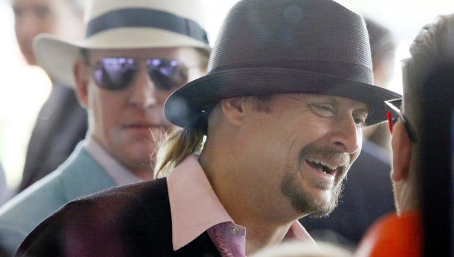 Singer Kid Rock talks with fans at the 143rd Kentucky Derby. May 6, 2017