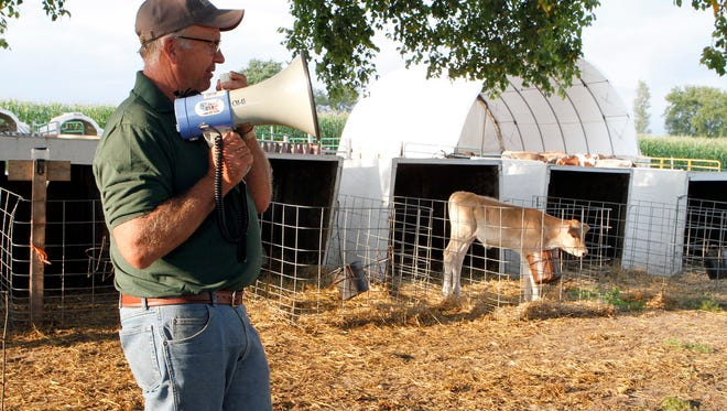 Tom Oberhaus, owner of Cozy Nook Farm in Waukesha County, talks about raising calves during a Professional Dairy Producers (PDPW) ACE Twilight meeting on Aug. 30, 2017.