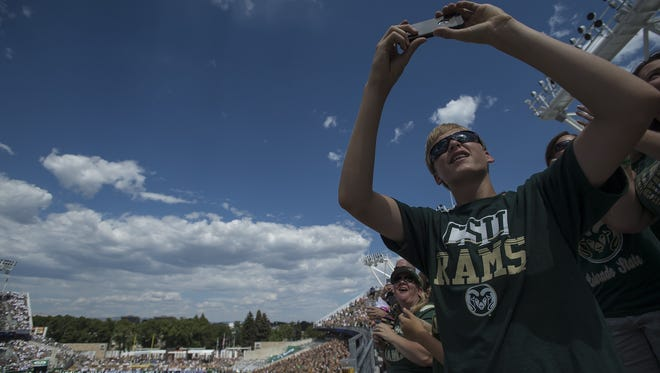 A fan films the flyover before the home-opening game between CSU and Oregon State on Saturday. Tthe game was sold out. Will Ram fans sell out against a lesser opponent  this week?