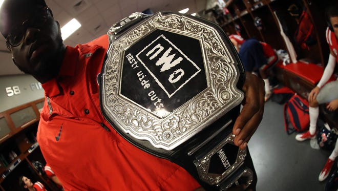 Ole Miss wide receivers coach Jacob Peeler gives a championship belt to one of his receivers every week.