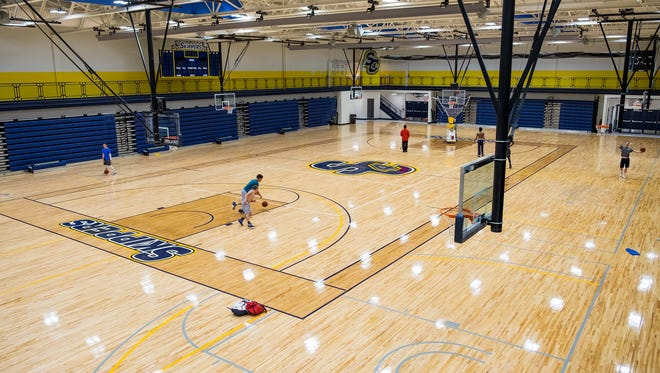 People play basketball on the new courts in the SC4 Fieldhouse. The college is being evaluated as a possible host to national championships in volleyball and women's basketball.