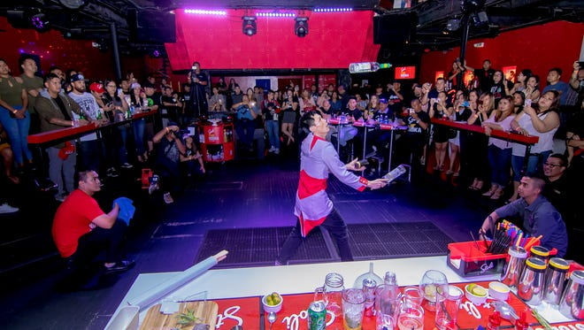 In this file photo, all eyes on Jun Navarro of Globe Ultra Lounge as he defends his title for the third time at the Stoli The Vodka's Bartender Competition held at Globe Ultra Lounge.