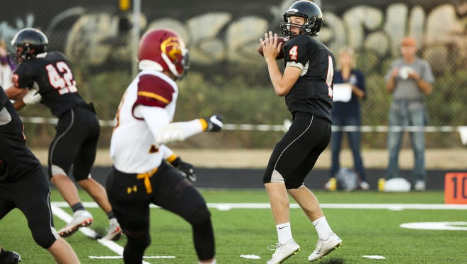 Silverton quarterback Levi Nielsen, pictured here in last year's season opener against Redmond, passed for 223 yards and two touchdowns in last Friday's 23-17 win against Sandy.