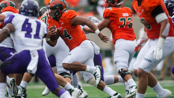 CSU running back Izzy Mathews (24) finds space, Saturday, Sept. 9, 2017, during a game against ACU at Sonny Lubick Field at Colorado State Stadium in Fort Collins, Colo.