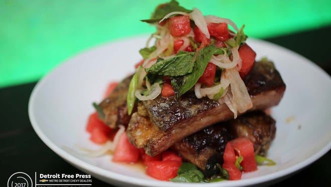 The crispy spare ribs ($17) at Katoi in Detroit's Corktown neighborhood are first smoked then cooked in a fish-sauce caramel and served with chunks of sweet watermelon, pickled rind and basil.