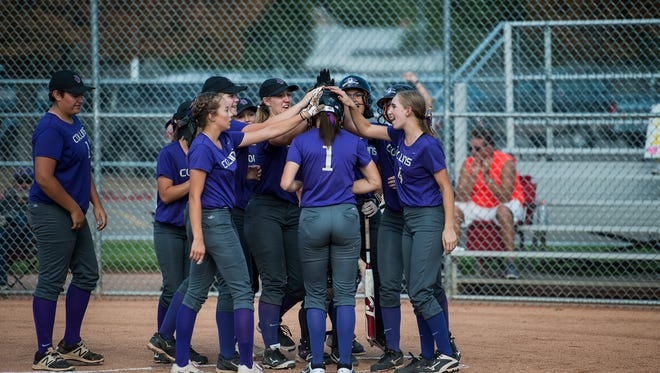 Fort Collins High School runner Jenn Dudash (1) is greeted by her teammates at home after hitting a home run during a game against Rocky Mountain High School, Tuesday afternoon, Sept. 12, 2017, at Rocky Mountain High School in Fort Collins, Colo.
