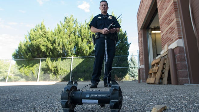 Loveland Police Department SWAT Lt. Brent Newbanks demonstrates how to use one of the department's smaller robots, Wednesday, Sept. 13, 2017, at the Loveland Police Department.