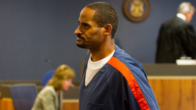 Robert Card Jr. is escorted out of his sentencing hearing Sept. 14. Card was sentence to 40 to 70 years in prison for the murder of John Allen.