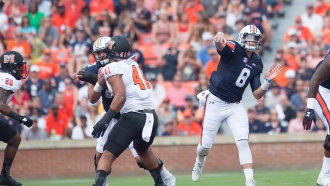Auburn quarterback Jarrett Stidham (8) throws a pass during the NCAA Football game between Auburn and Mercer on Saturday, Sept. 16, 2017, in Auburn, Ala. Auburn defeated Mercer 24-10.