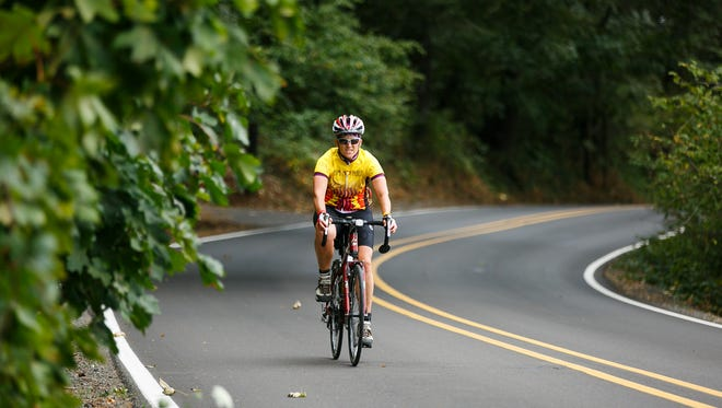 Participants cycle from Spong's Landing outside of Keizer to Silver Falls State Park in the River 2 Ridge event on Sunday, Sept. 17, 2017. Participants kayaked the 6.2 miles from Salem's Riverfront Park to Spong's Landing north of Salem, then biked 47.8 miles to Silver Falls, where they ran a 5.8-mile loop of the state park.
