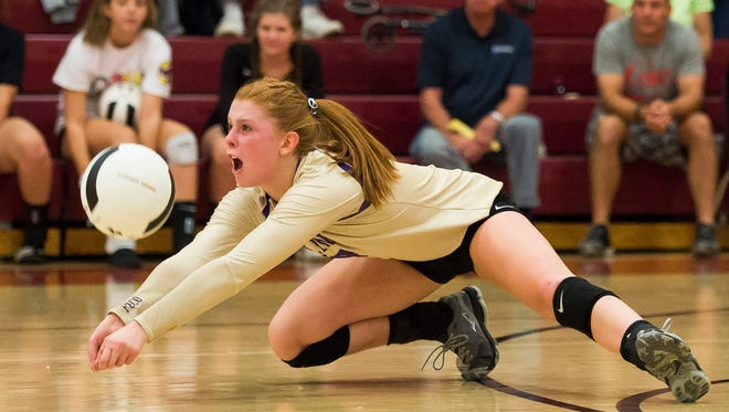 Fort Collins High School defensive specialist Erika Jones (17) digs a spiked ball during a game against Rocky Mountain High School, Tuesday, Sept. 19, 2017, at Rocky Mountain High School in Fort Collins, Colo.